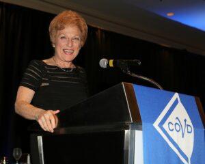 Dr. Lynn Hellerstein, MC at COVD Banquet