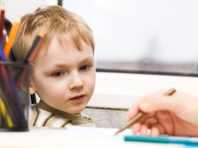 Little boy studies to draw